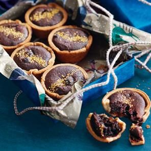 Paul A Young's brownie mince pies recipe. These pies are a cross between a classic boozy mince pie and a gooey brownie.