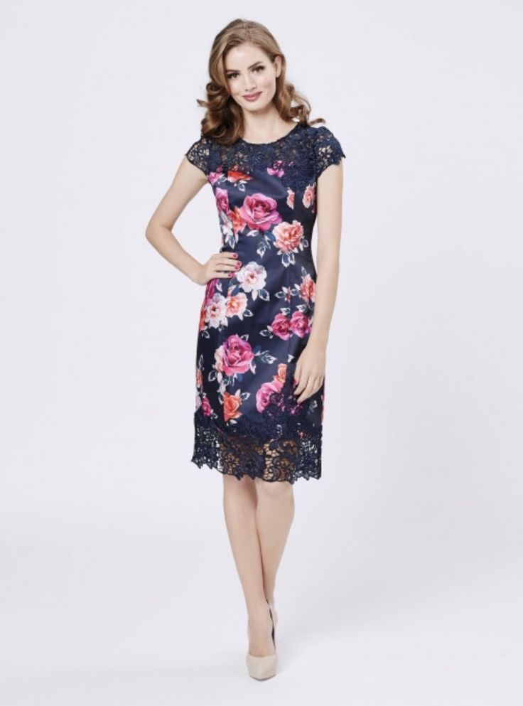 Floral prints look elegant with dark background fabric. They are also slimming. Wear a nude or neutral shoe and lipstick to keep it classy.  Photo credit: review-australia.com