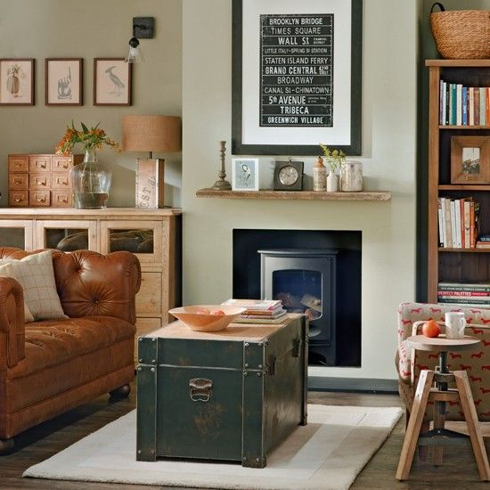 A storage trunk adds a sense of heritage and interest to this living room. In a snug space, it also doubles up as a coffee table. The Chesterfield-style sofa adds a classic touch.