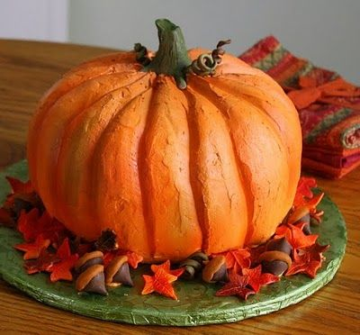 """Pumpkin Cake:This one is made from layers that are stacked and carved into the desired pumpkin shape - pinned only because of the finished presentation - I prefer the """"two bundt cakes iced together"""" method to this."""