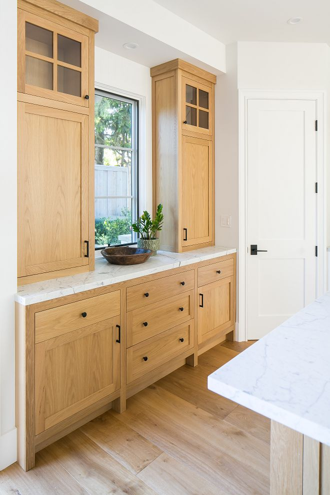 White Oak Kitchen Buffet Cabinet With White Marble Countertop And Black Hardware Kitchen Cabinets Decor Kitchen Cabinets Oak Kitchen Cabinets