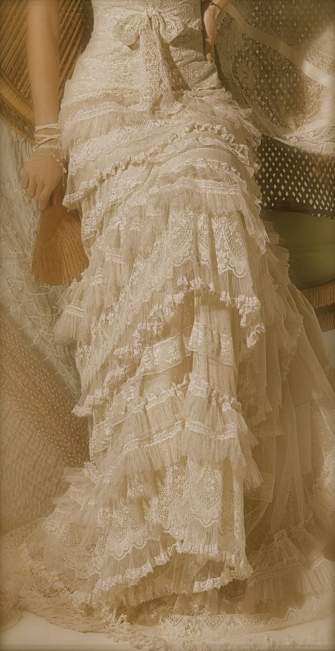 Love layered lace like this -- http://bcr8tive.com/yolan-cris-2013-ibiza-bridal-collection/