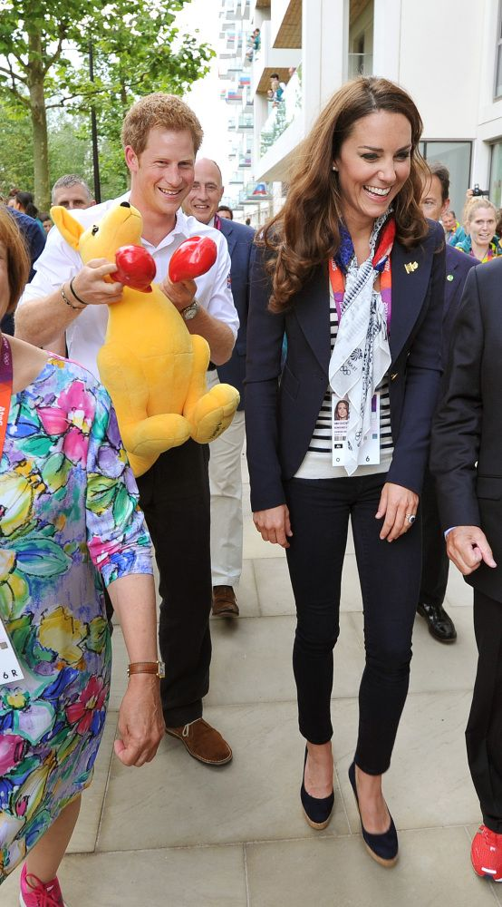 Prince Harry holds a Kangaroo given to him by Australian athletes as he walks with the Duchess of Cambridge during a visit to the Team GB accommodation flats in the Athletes Village at the Olympic Park in Stratford, east London.  PA Wire/Press Association Images