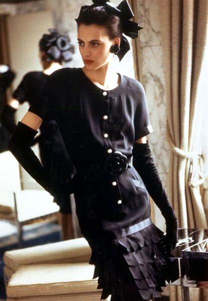 Inès de la Fressange sporting a classic Chanel ensemble during her heyday.