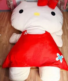 This Hello Kitty supersize pillow bed  is exactly what I've been looking for. My cats used to have a huge plush fish they would sit on al...