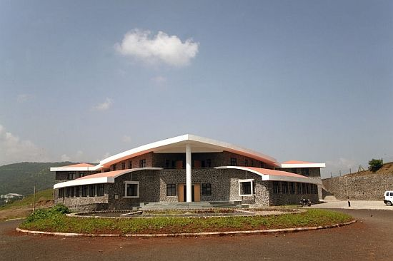 This sustainable school has been constructed in Pune, Maharashtra, India. The school is the first military school for girls in India and has been built with sustainability as one of the main criteria. The building comes with a gray water recycling system to reuse waste water. The courtyards are covered with polycarbonate sheets, which protect the corridors from rainfall, and by maximizing they also reduce the amount of energy required to illuminate the interiors.