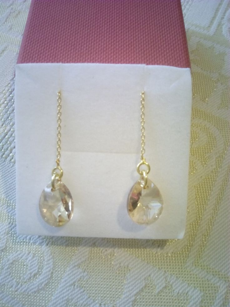 Gold plated silver earrings with golden shadow Swarovski teardrop crystals.