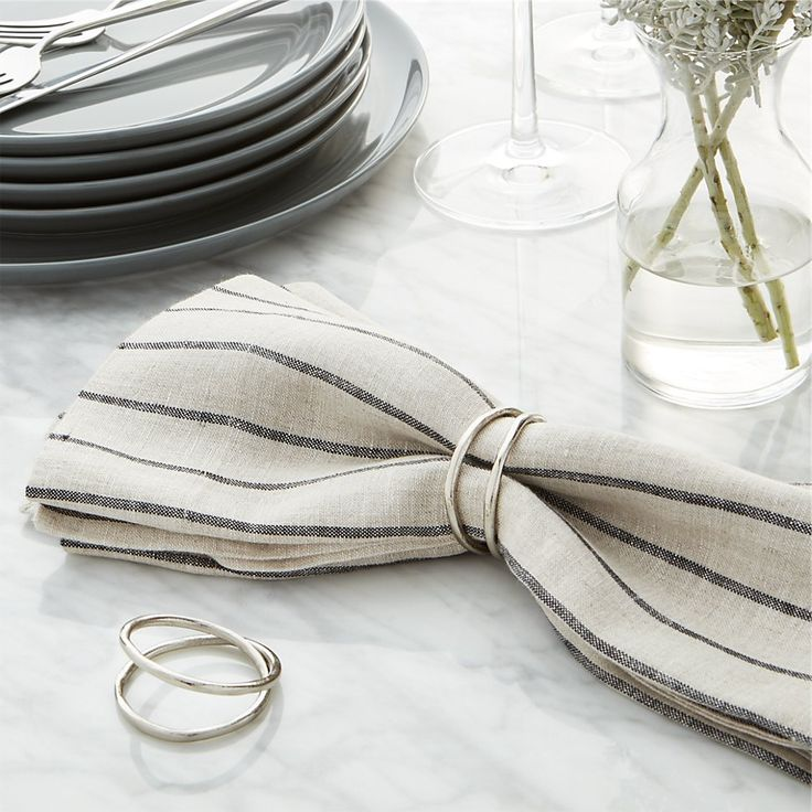 Shop Aria Silver Napkin Ring. Two rings of recycled brass with a soft silver fashion a simple, organic napkin ring.