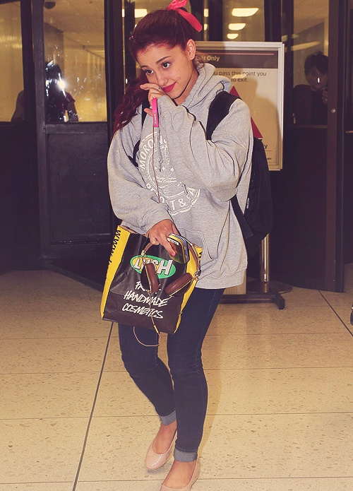 Ariana grande... I really like the outfit. Nude flats, skinny jeans, and baggy sweatshirt.  and the bow