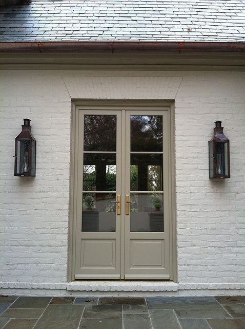 greige brick and doors (?) with lanterns