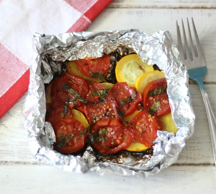 Grilled Zucchini and Tomato Packets - An easy do it yourself foil packet cooked on the grill filled zucchini and tomatoes and seasonings.