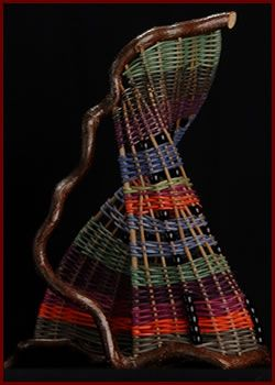 Pitcher is a free-standing sculpture woven by master basket weaver Tina Puckett of Winsted, CT