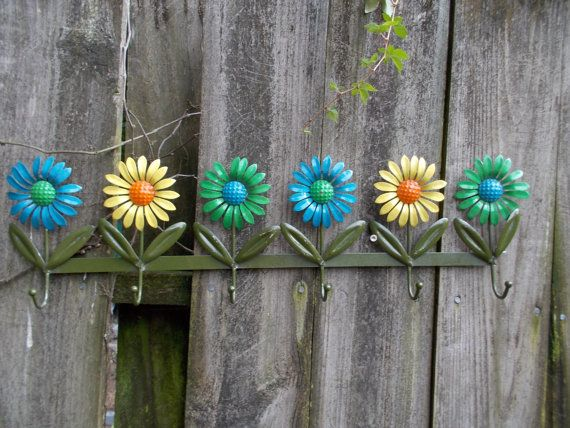 vintage metal wall hook with yellow blue and green by terriannes