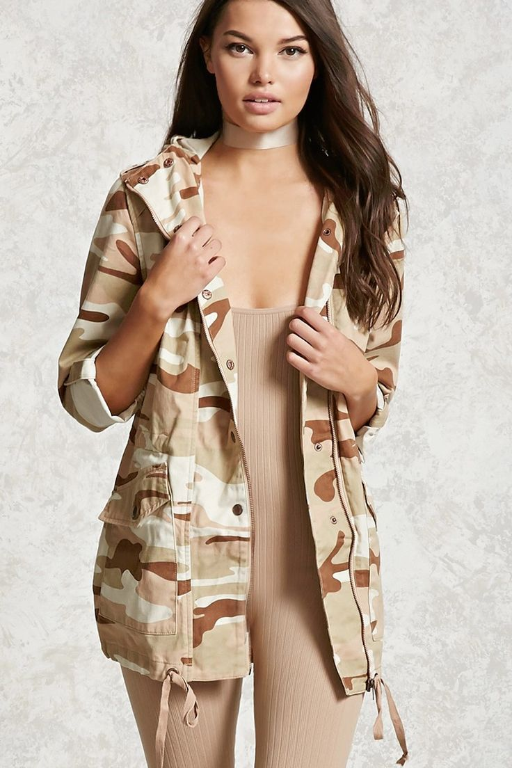 A hooded utility jacket featuring allover camo print, buttoned epaulettes, snap-button long sleeves, a zippered front closure, a snap-button placket, buttoned front flap pockets, an interior drawstring, and a drawstring hem.