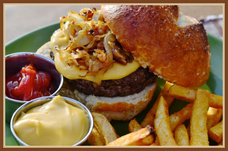 Beer Cheese Pretzel Burger-Pretzel bun topped with Beer Cheese, caramelized onions, and a grilled burger.