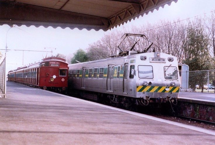 A Hitachi and a Tait swing door red rattler on the Port Melbourne line before conversion to light rail (a big mistake) in 1987