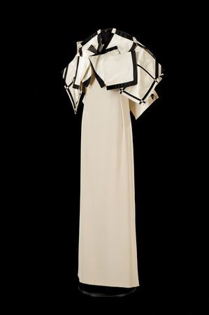 'Sculpture Dress' , 1987. By Roberto Capucci (Italian, b. 1930). Museo di Palazzo Venezia Rome. Sculpture-dress, butter colored crepe, satin bolero with white squares and black inlays.