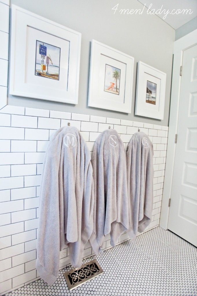 Penny tile floors and subway tile walls make an elegant bathroom combination. Learn more about how the penny tile holds up to wear and tear from Michelle of 4 Men 1 Lady. || @4men1Lady