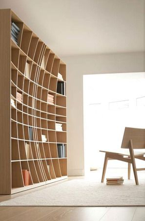 This is no optical illusion, but a very groovy curvy bookshelf in oak from Joined + Jointed by Simon Pengelly.