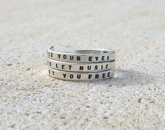"""This ring with the beloved lyric """"Close your eyes and let music set you free"""" from Phantom of the Opera.   34 Products That Anyone Obsessed With Broadway Needs"""