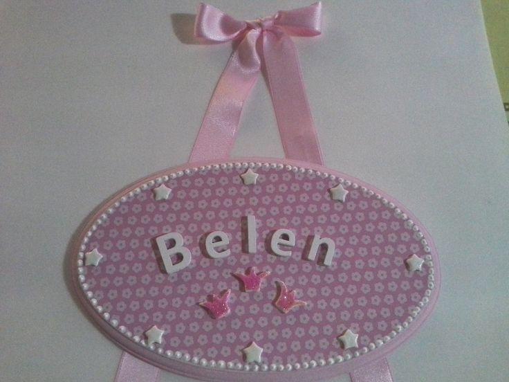 Cartel oval rosa con estrellas y cinta de raso