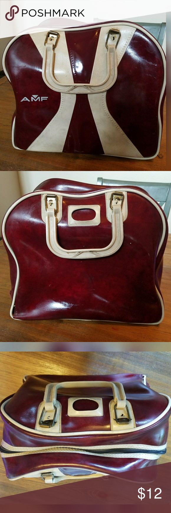 Rad, VINTAGE, AMF, bowling bag!! Great colors and design. Brand is AMF. Zipper closure. Inside side pocket. Burgundy and cream colors. Ball holder has been removed. Some tears (one medium sized one on side - See 7th pic) and definite signs of wear. Imperfections reflected in price. Vintage Bags