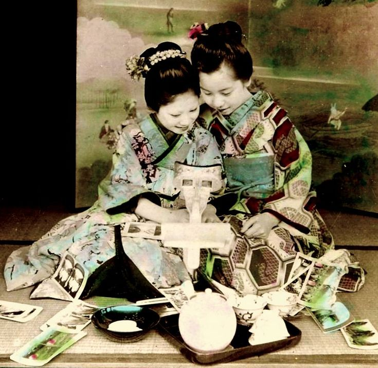 Two Maiko with a stereoscope and views, 1904 by Julian Cochrane