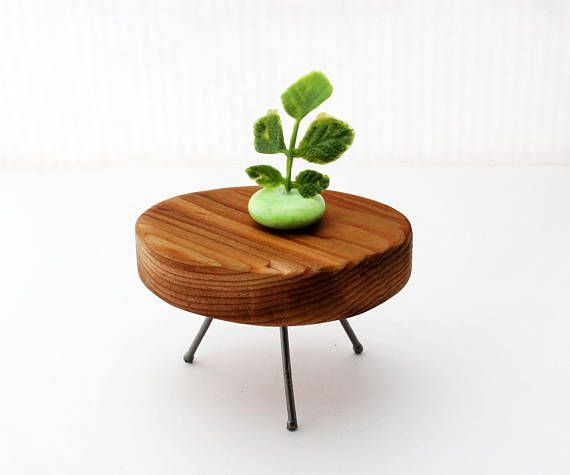 Stunning, simple miniature side table made from reclaimed cedar wood. This lovely little round table smells as good as it feels! Soft edges and smooth wood make this table as fun to hold as it is to decorate with in your miniature space. The legs are made from galvanized nails and it