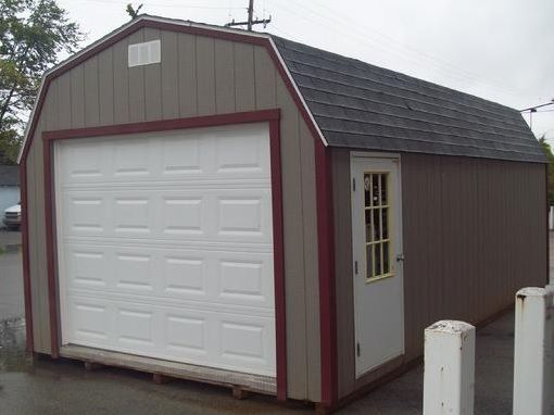 Portable metal garage with side entry