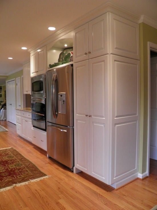 Galley Kitchen Design with floor to ceiling cabinet