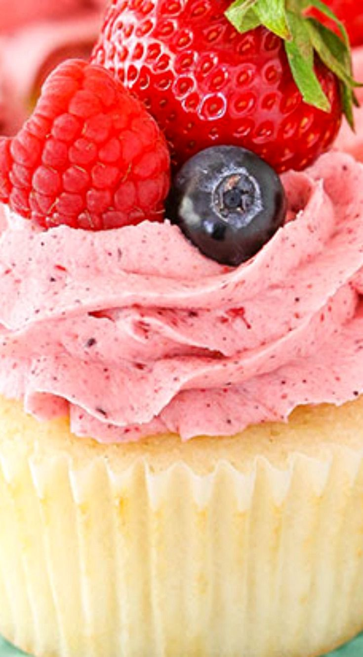 Berries and Cream Cupcakes ~ Made with a moist vanilla cupcake, whipped almond filling and mixed berry frosting! They are topped with more fresh berries for a cupcake that is not only delicious, but perfect for summer!