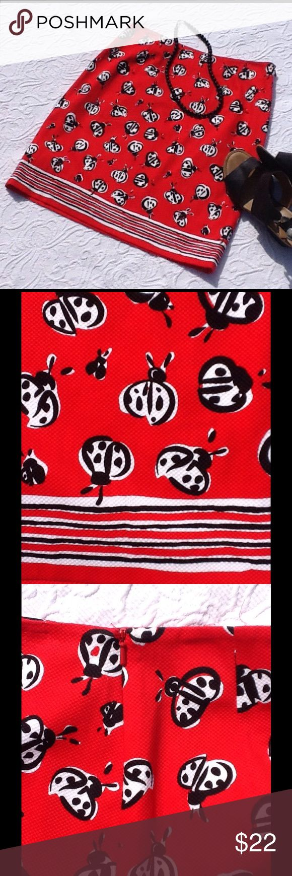 """Talbots ladybug skirt How cute is this? Red background with black & white ladybugs. Bottom stripes create a cute border. Hidden side zipper. 97% cotton, 3% spandex; machine wash cold. Pre-loved condition with no visible rips, stains, or tears. Approximate measurements: waist 30"""", length from waist to hem 20.5"""". Talbots Skirts"""