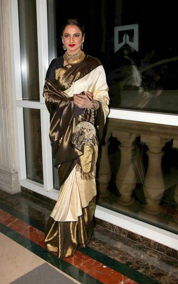 Evergreen beauty #Rekha dazzled in a off-white #saree with #blingy border. Statement #jewellery and red lip complemented her look
