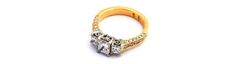 Custom made 18ct yellow gold and Palladium engagement ring.