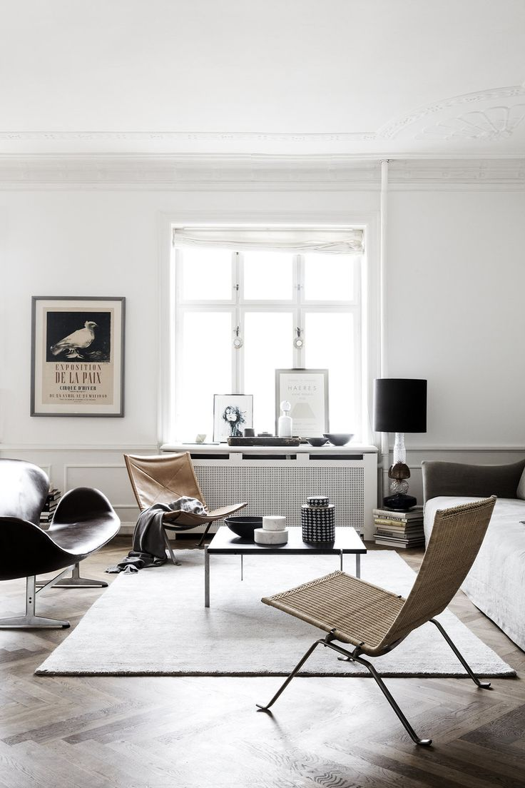 This home photographed for ELLE Decoration Denmark caught my eye last week.  I love all of the detail and thought that has gone it to styling this small  space. The beautiful parquet floors and art deco ceilings make for the  perfect backdrop to the eclectic furnishings - a subtle contrast of  materials and textures which work so well together. While I always tend to  lean towards a minimalist palette of black and white, the tiny splices of  colour throughout this place work so beautiful...