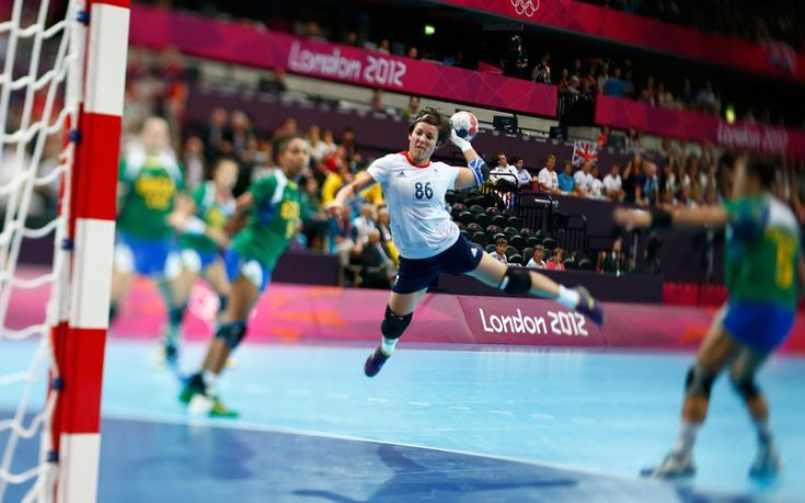 Britain's Marie Gerbron takes a shot against Brazil in their women's handball Preliminaries Group A match at the Copper Box venue