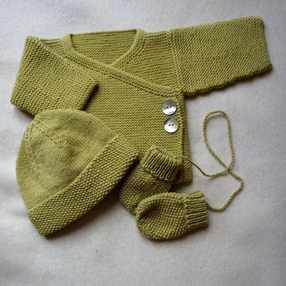Newbie Jacket is hand knitted using 100% superfine merino wool with a wrap front, closed with two shell buttons and a small tie inside. Beautifully soft, warm and comfortable for babies. This Jacket is featured in Limey but available in a selection of beautiful colours. Sizes range from NB-6mths Team with NEWBIE hat and mittens. This listing is for one jacket only Machine wash on a wool cycle or hand washed at 30o. Your hat will arrive wrapped in white tissue. Thanks to Joji Locatelli fo...