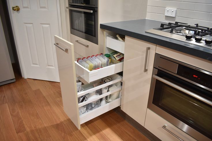 Do you want lots of drawers in your kitchen, but keep a sleek design? Have a look at our internal drawers and hide your drawers behind a bigger one! #joycekitchens #kitchenrenovation #kitchendesign