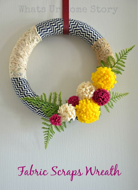Say hello to Spring with this beautiful wreath made out felt flowers and fabric scraps. Tutorial at www.whatsurhomestory.com