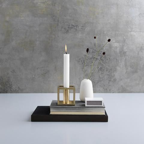 Obsessed! This candle holder is just something else. It's  clean lines just draw the eye in. Kubus 1 Candleholder in Brass by Lassen - Made Modern - 1