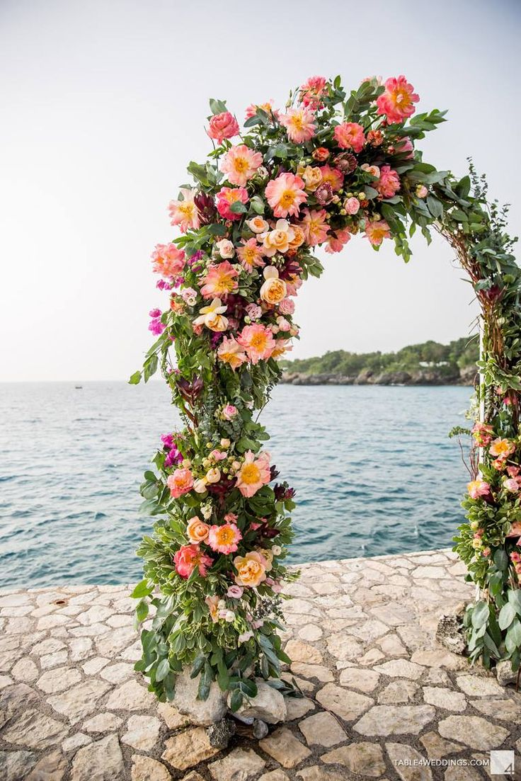 Our wedding Rockhouse Hotel in Negril Jamaica   peony floral arch beach wedding cliff florist   Floral by GRO Designs   Bridesmaids dresses by Joanna August   Destination wedding, peach wedding Shannon Skloss www.shannonsklossweddings.com   photography by Table4 weddings