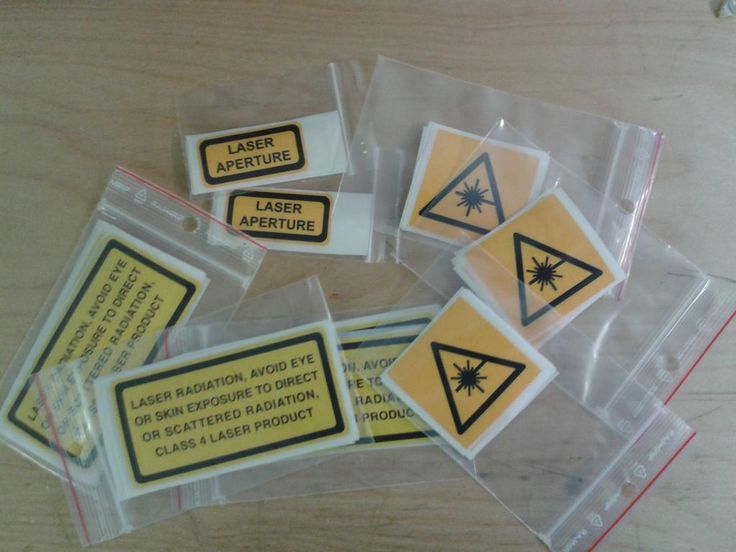 Laser aperture warning labels