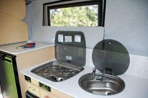 Flush Mounted Three Burner Propane Stove And A Large Sink
