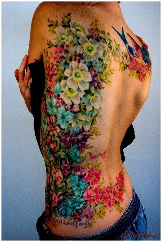 Татуировка большая, цветы и ласточки
