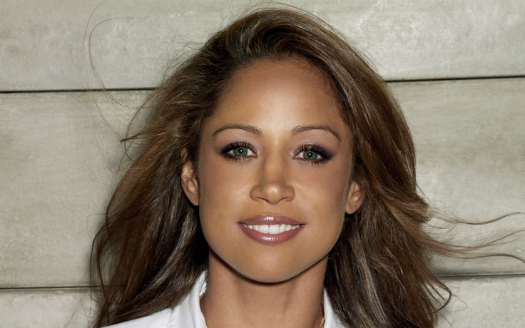 Stacey Dash... I think Kay will resemble her when she's older... same hair color, eyes and skin tone.