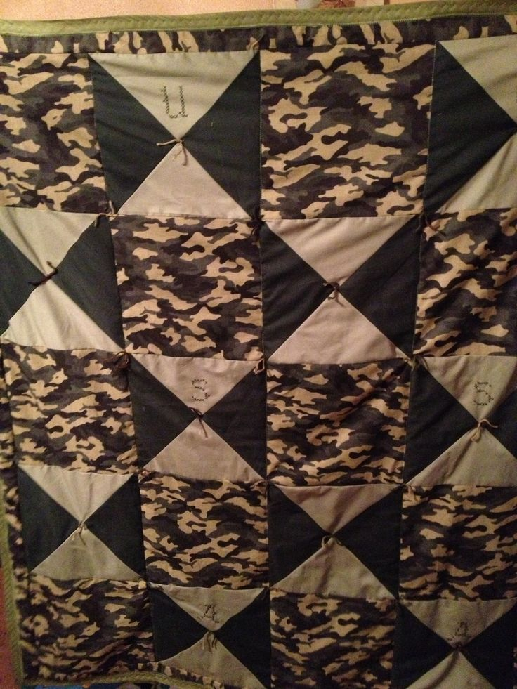 Camo quilt with USA cross stitch in blocks.