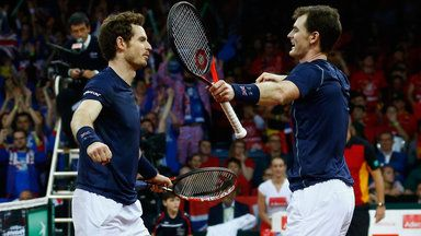 Jamie Murray and Andy Murray of Great Britain celebrate defeating Steve Darcis and David Goffin of Belgium
