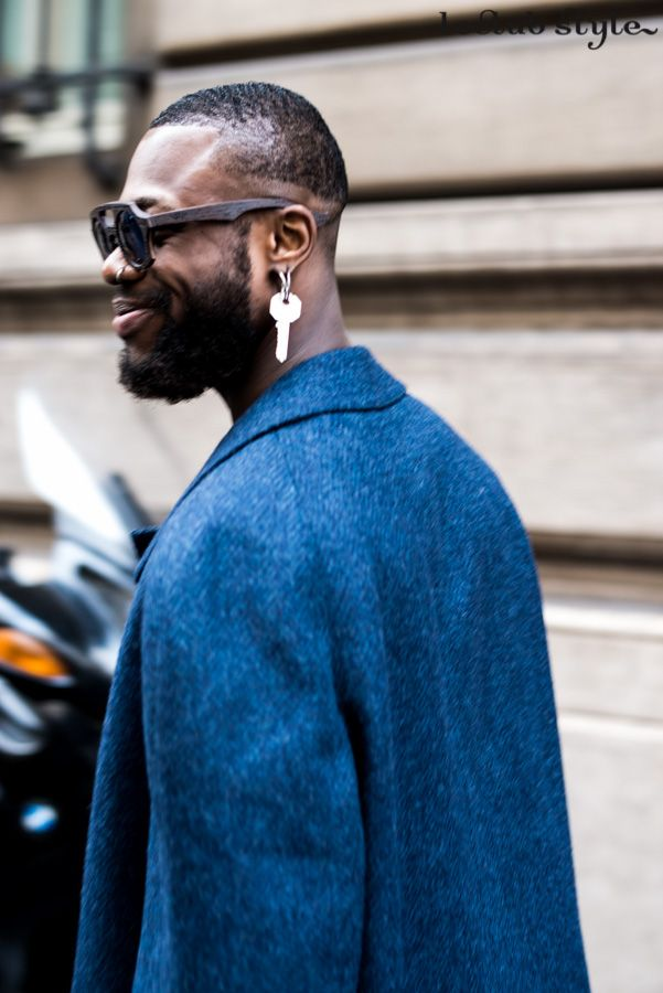 Menswear Street Style by Ángel Robles. Blue coat, sunglasses and key earring at Lanvin show, Paris Fashion Week. On the street, Rue Bonaparte, Paris.