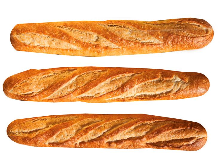 This recipe reduces the length of traditional baguette to fit in home ovens and calls for adding ice cubes to a hot cast-iron skillet to create steam.