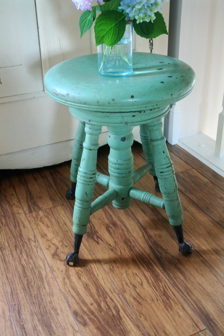 My grandparents had a piano stool like this (only, of course, not funky teal.)  I loved that thing.  I was particularly fascinated by the claw-and-marble feet.  I don't play the piano, and that particular stool went missing when Grandma moved out of her house, but I can imagine this kind of thing catching clutter in our living room...and me PRETENDING it's the same one, found its way back home to me.
